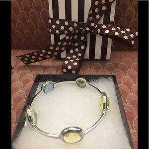 2 Henri Bendel boxed bangles with glass jewels.